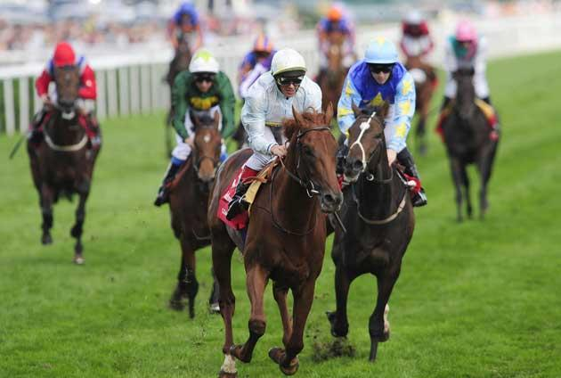 Conduit and Frankie Dettori (centre) easily take the St Leger at Doncaster yesterday ahead of Unsung Heroine