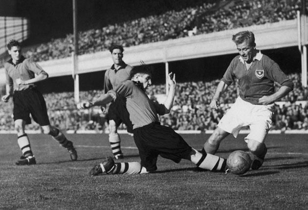 Wolves' Shorthouse tackles Jack Froggatt of Portsmouth during the 1949 Charity Shield