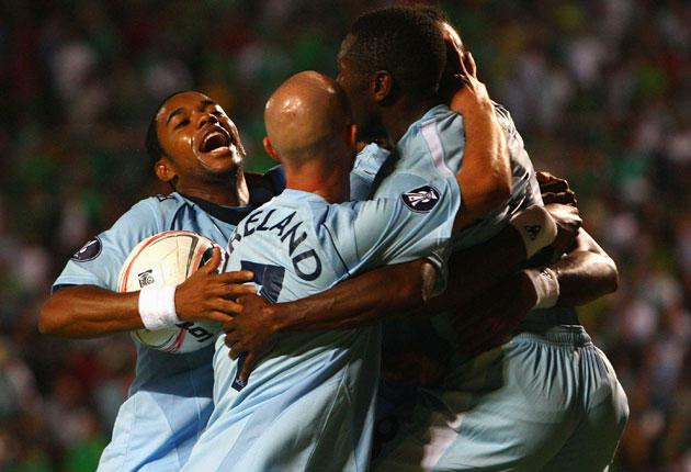 Robinho (left) leads the Manchester City celebrations after Jo scored the equaliser against Omonia Nicosia in Cyprus