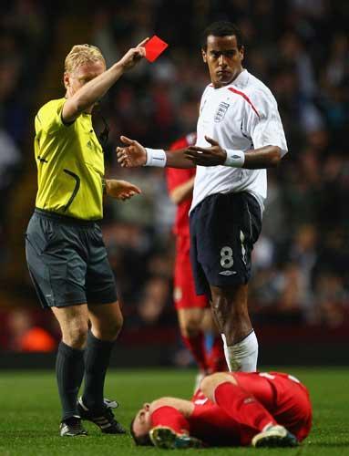 England Under-21 midfielder Tom Huddlestone is sent off for a dangerous challenge on Wales' Darcy Blake