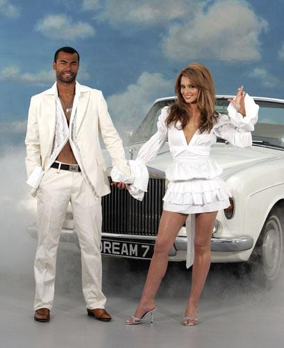 Ashley Cole, pictured with his wife Cheryl, is one of a number of players criticised for an extravagant lifestyle