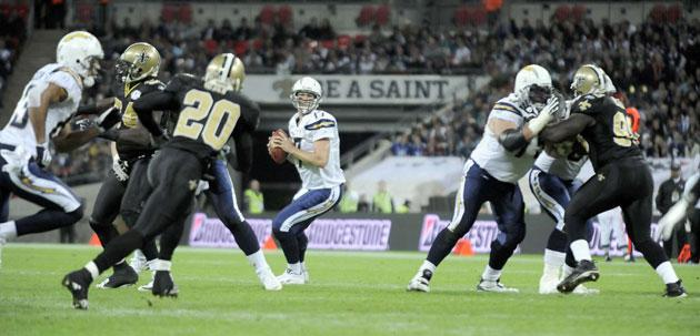 The San Diego Chargers quarterback, Philip Rivers, weighs up his passing options in an eventful and closely fought encounter with the New Orleans Saints at Wembley yesterday