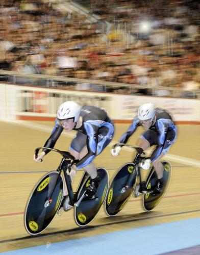 Jason Kenny and Ross Edgar on their way to winning gold in the men's team sprint final