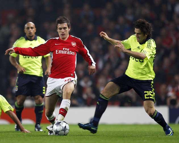 Aaron Ramsey of Arsenal is tackled by Fenerbahce's Ugur Boral (right) at the Emirates Stadium last night