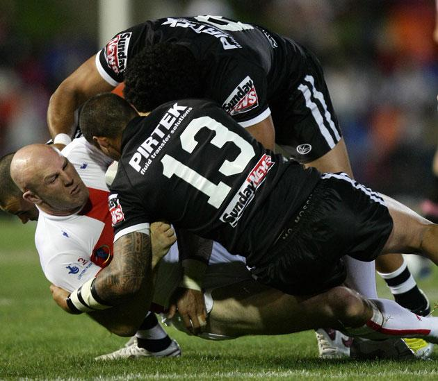 Centre Keith Senior is tackled by the New Zealand forwards Jeremy Smith (13) and Adam Blair during England's 36-24 defeat in the Rugby League World Cup in Newcastle, Australia, on Saturday