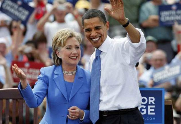 On the campaign trail: Barack Obama and Hillary Clinton take the stage in Unity, New Hampshire, earlier this year. The former First Lady may now be offered a senior post in the president-elect's cabinet