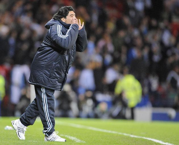 New Argentina coach Diego Maradona shouts instructions to his players during a friendly football match against Scotland last night at Hampden Park