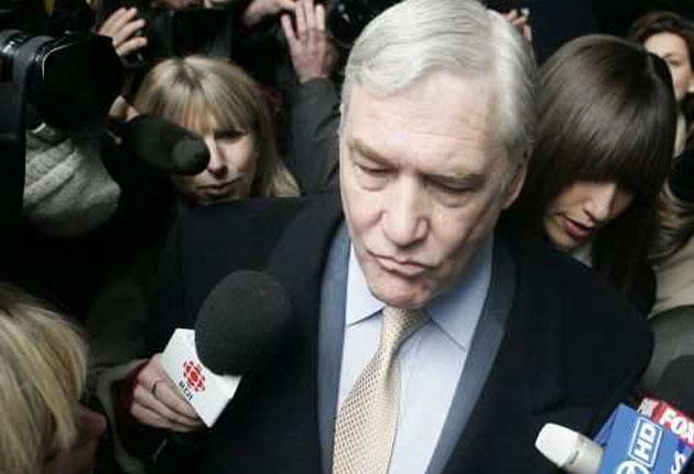Conrad Black leaves court after being sentenced last year