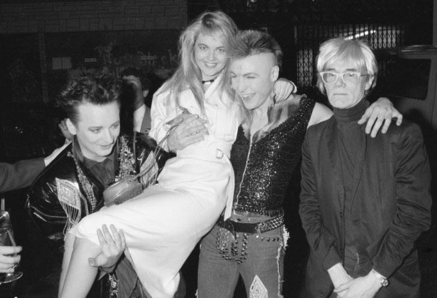 English pop singers Boy George (left) and Marilyn with American pop artist Andy Warhhol and a friend, May 1985.