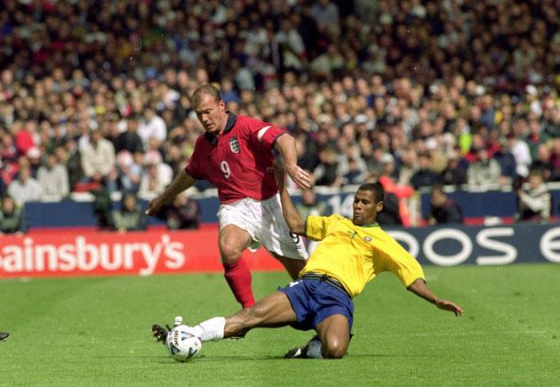 Alan Shearer's charge for goal is thwarted by Aldair during England's 1-1 draw with Brazil in the friendly international at Wembley in May 2000