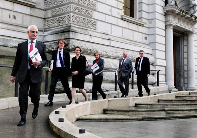 MrDarling, trailed by his Treasury team, heads for Parliament to deliver his pre-Budget report.