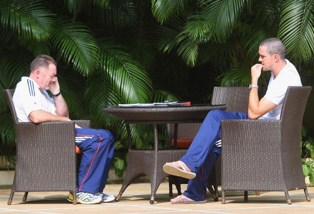The England captain,Kevin Pietersen (right), talks to security expert Reg Dickinson at the team's hotel in Bhubaneswar yesterday
