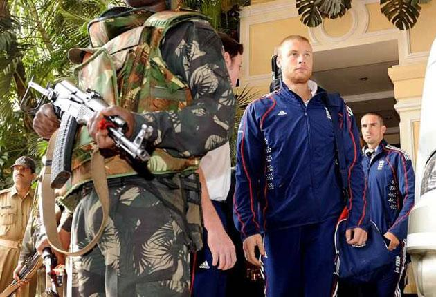 England's Andrew Flintoff and captain Kevin Pietersen (right) leave the team hotel in Bhubaneswar under armed guard before flying to Bangalore, where they were due to catch the flight home