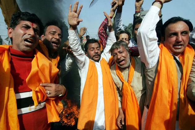 Activists of the right-wing Hindu Shiv Sena party shout slogans against Pakistan's intelligence agency at a demonstration in the city of Amritsar yesterday