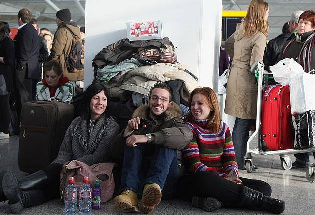 Passengers wait for flights in the Stansted terminal after protesters caused major delays by occupying a secure area near the runway