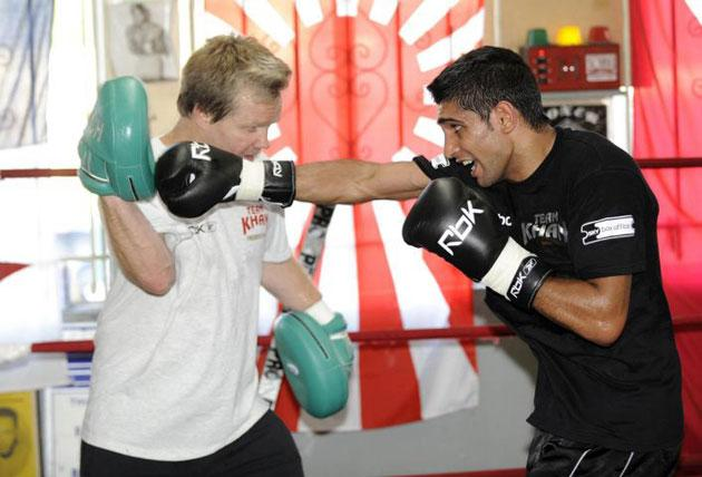 Amir Khan (right) has got back to basics with new trainer Freddie Roach, but needs to step beyond his comfort zone