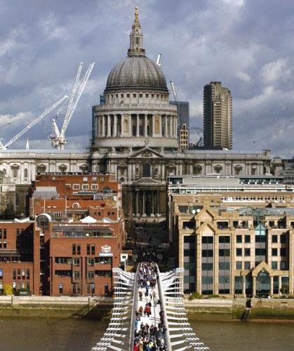 Thousands of people pack the Millennium Bridge in London when it re-opened in 2002