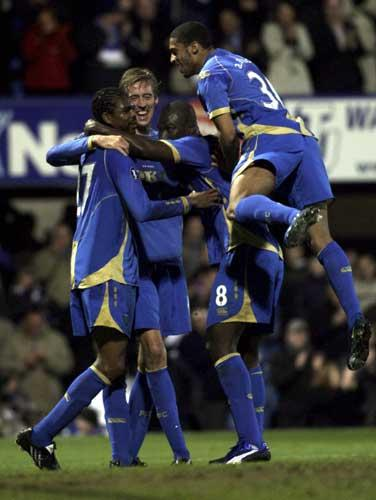 Portsmouth players celebrate Peter Crouch's second goal at Fratton Park