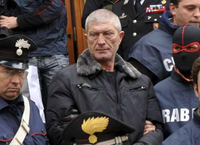 Gaetano Lo Presti is led away by police after his arrest in Palermo on Tuesday