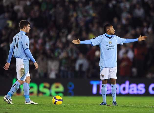 Robinho (right) shows his frustration during last night's Uefa Cup match with Racing Santander