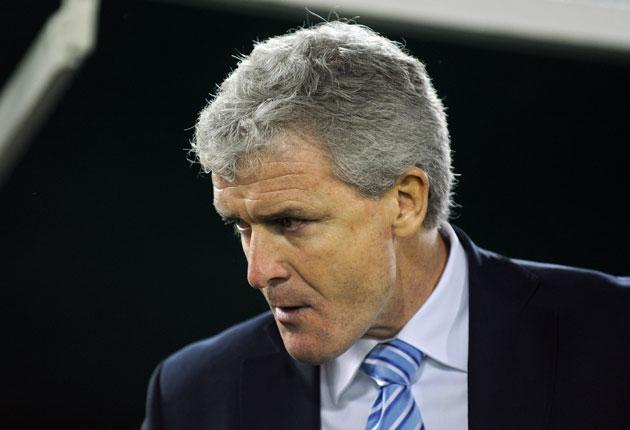 Mark Hughes, the Manchester City manager, whose struggling side play high-flying Hull City today