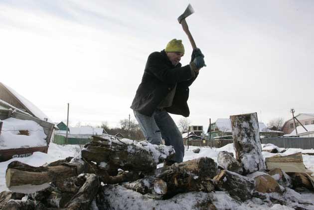 A man chops firewood near Kiev on Friday