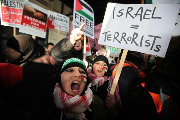 Protesters march to Trafalgar Square to demonstrate against the recent attacks on Gaza