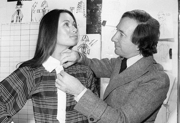 'My clothes make anyone look 10 pounds slimmer and 10 years younger': Lapidus with a model in 1976