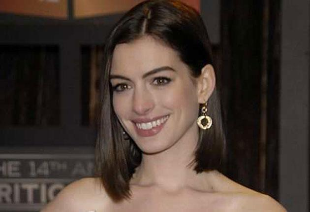 A gold asterisk placed by Anne Hathaway's name on the organiser's website indicated she had won