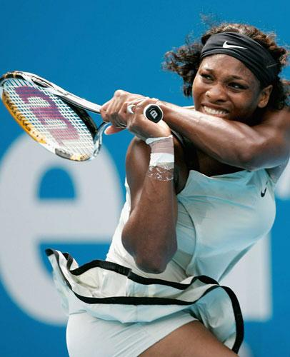 Serena Williams hits a backhand as she falls to a straight-sets defeat to Elena Dementieva in the semi-finals of the Sydney International yesterday