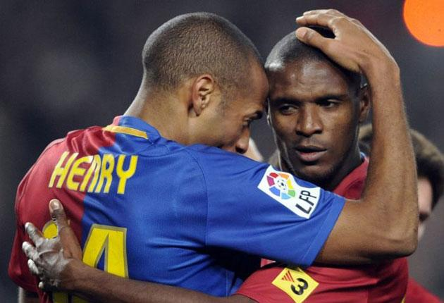 Thierry Henry (left) celebrates with Eric Abidal after scoring in Saturday's demolition of Deportivo La Coruña
