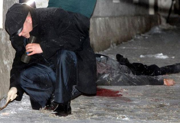 An investigator works near the body of the murdered lawyer Stanislav Markelov in central Moscow, yesterday. A journalist was wounded in the attack