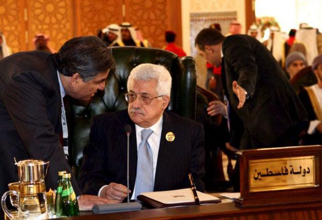 Palestinian President Mahmoud Abbas, seated, at the Arab Economic Summit in Kuwait yesterday