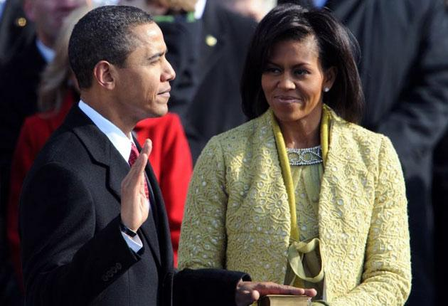 Barack Obama swears the oath and becomes the 44th President of the United States of America
