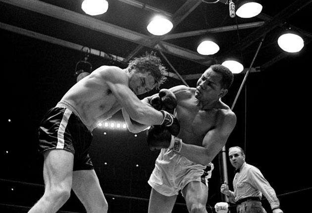 Torres lands a right to the face of Wayne Thornton on the way to retaining his world light-heavyweight title by unanimous decision at Shea Stadium, NY, in May 1966