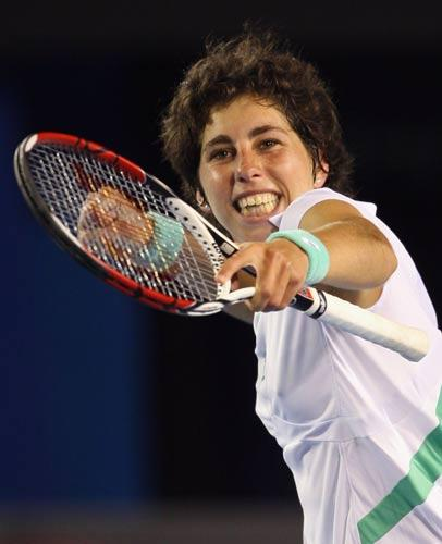 Carla Suarez Navarro of Spain celebrates winning match point after her second round match against Venus Williams