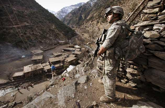 A soldier on patrol in Afghanistan last week. Up to 30,000 more US troops may be sent in by the summer