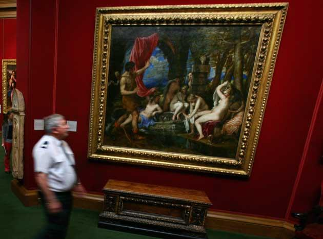 An attendant at the National Galleries of Scotland admires Titian's 'Diana and Actaeon'