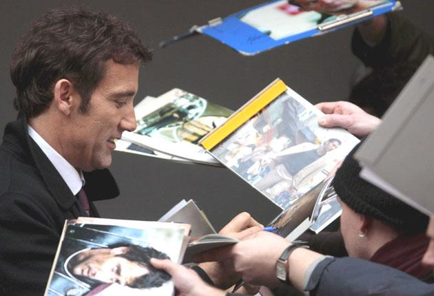 Clive Owen signs autographs at the Berlin film festival yesterday
