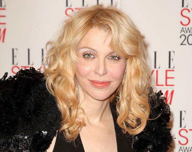 Former Hole singer Courtney Love was awarded Woman of the Year.