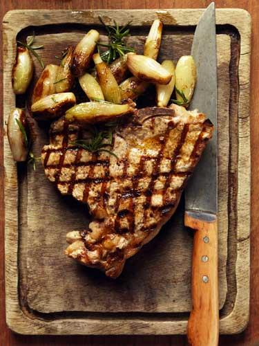 Veal T-bone with roasted shallots and rosemary