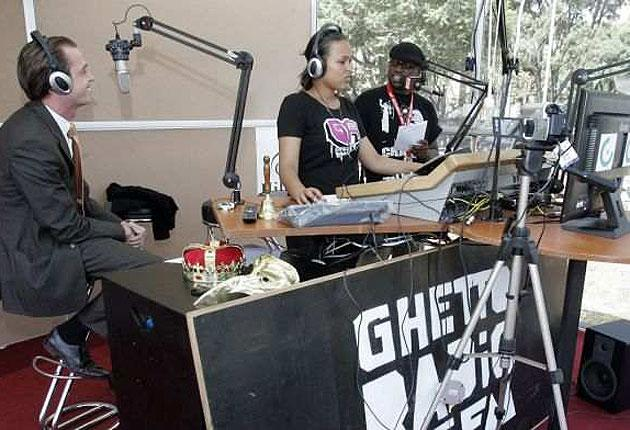 Kenyan Ghetto Radio station presenter Muki Garang (right) chats over the mike at the glass house in capital Nairobi