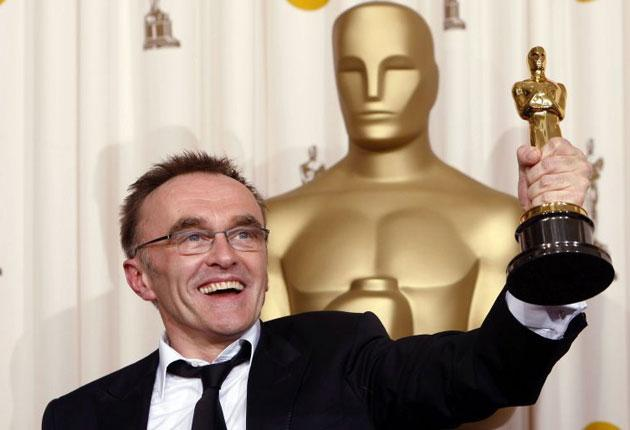 British director Danny Boyle kisses best director Oscar at 81st Academy Awards in Hollywood