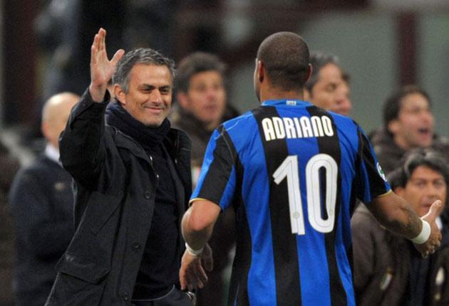 The Internazionale striker Adriano runs to hug his manager Jose Mourinho after scoring in the Milan derby