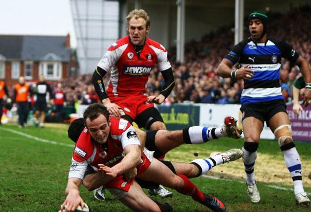 Sharp finish: young Gloucester back Charlie Sharples scores a try during the victory over Bath which keeps the Cherry and Whites at the top of the table