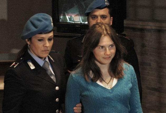 Amanda Knox is escorted into the courtroom yesterday