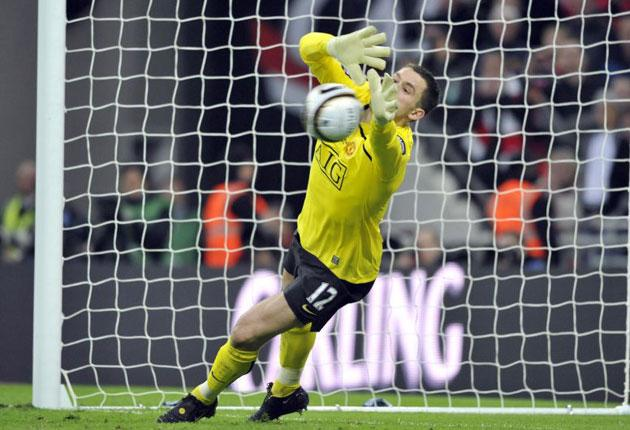 The Manchester United goalkeeper Ben Foster saves the first penalty, taken by Tottenham's Jamie O'Hara, at Wembley on Sunday