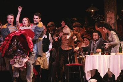 "Ainhoa Arteta  as ""Musetta"", second from left,  and Angela Gheorghiu as ""Mimi"", far right, and Ramon Vargas as ""Rodolfo,"" second from right, in their starring roles during the dress rehearsal of  the Franco Zeffirelli opera ""La Boheme"" at the Metropolitan"