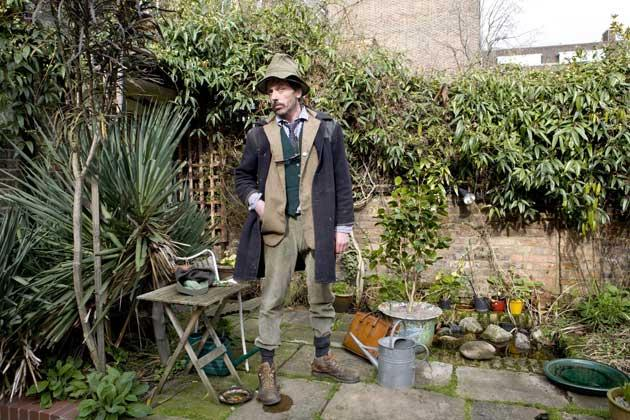 Weeds and tweeds: Andy goes to work in a Westwood-designed three-piece suit