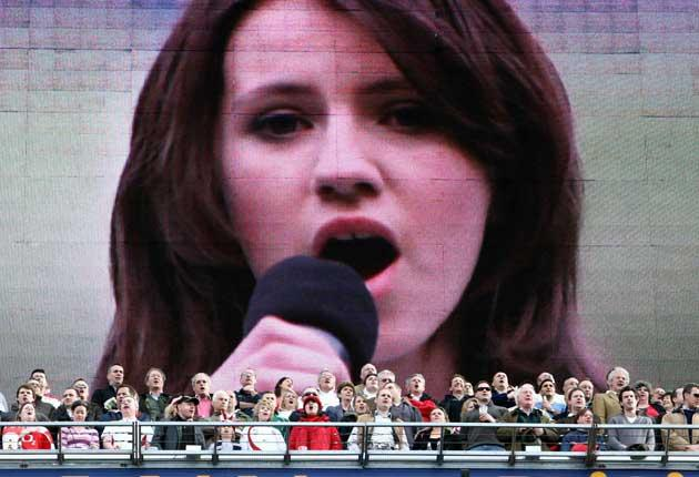 Screen starlet: Faryl Smith pictured on the big screen singing before the England versus France rugby union match at Twickenham last Sunday